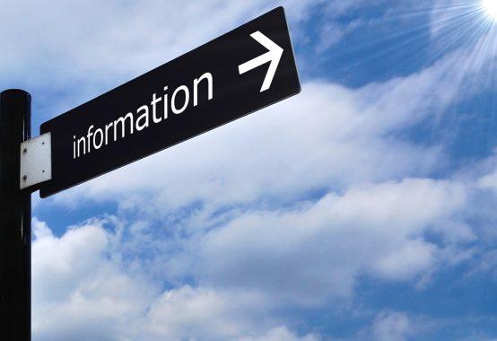 information と記載された標識と空と太陽